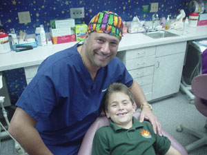 Dr. Joe Herman with a happy patient after a checkup.